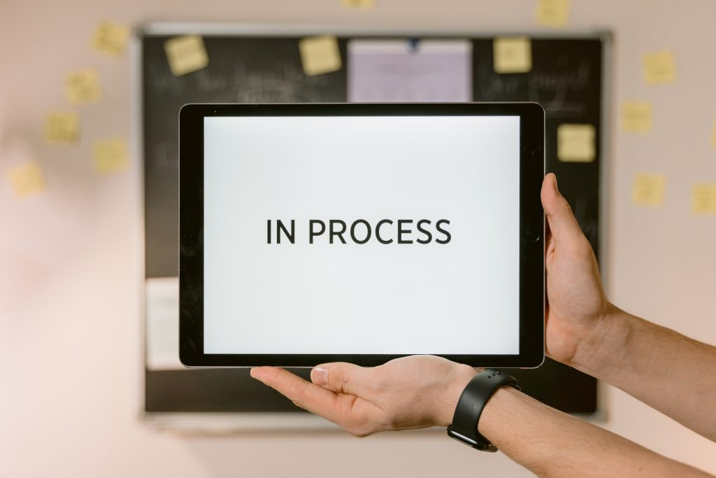 a screen displaying the words 'in process'